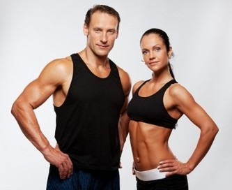 Image of a male and a female fitness trainer posing for the camera.
