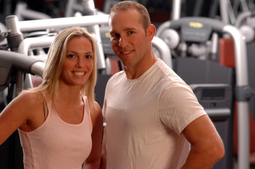 Photo of male and female personal fitness trainers in a gym location.