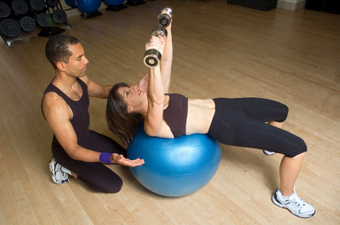 Photo of personal trainer in action with client.