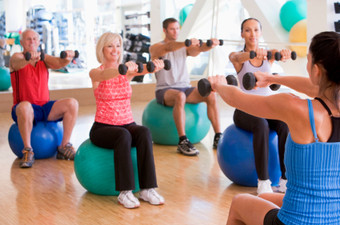 Photo of an Exercise Ball Fitness Workout Class in progress.