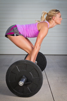 Image of a female client performing an Olympic lift.