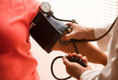 Image of a special populations fitness client having her blood pressure measured.